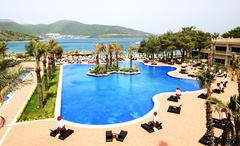 swimming pools and beach at luxury hotel, bodrum, turkey - stock photo