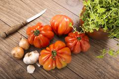 Beefsteak tomatoes, onions, garlic and oregano, raw, Low Carb - stock photo