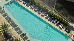 Swimming Pool Aerial - Hotel Window View of Swimmer in Las Vegas Resort Stock Footage