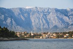 Croatia, Brac, Sumartin, Townscape of Makarska with Biokovo mountains in Stock Photos