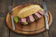 Stock Photo of Steak-Burger with beefsteak and salad on chopping board