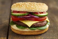 Cheeseburger, close-up Stock Photos