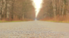 Move along the road,man walking along the road Stock Footage