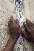 afro- american packing note to the god into the western wall in jerusalem. - stock photo