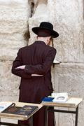 jew prays in the wailing wall in jerusalem. - stock photo