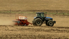 Farmers sowing maize with tractors and planters Stock Footage