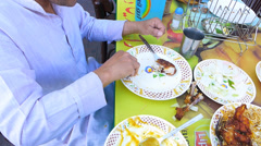 Dubai Pakistani foreign worker eating at outdoor Pakistan restaurant UAE Stock Footage