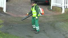Man using leaf blower Stock Footage