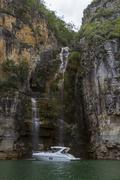 Luxury cruiser in deep water canyon Furnas Hydroelectric Lake - stock photo