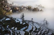 Stock Photo of China, Yunnan, Yuanyang, Overcast rice terraces and village