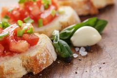 Simple italian appetizing bruschetta with tomato Stock Photos