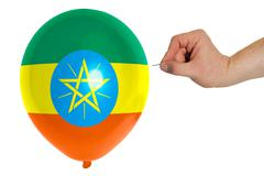 Bursting balloon colored in  national flag of ethiopia Stock Photos