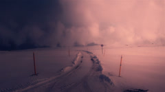 Desolate Icelandic glacier mountain road in winter, dramatic lighting Stock Footage
