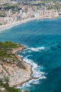 coastline of mediterranean resort calpe, spain with sea and lake - stock photo