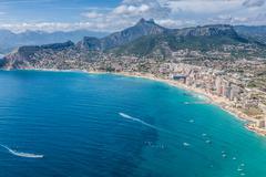 Stock Photo of coastline of mediterranean resort calpe, spain with sea and lake