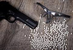 airsoft gun with glasses - stock photo