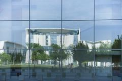 Germany, Berlin, chancellor's office reflecting in glass facade - stock photo