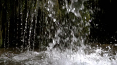 Small stream of waterfall flow of mosses in slow motion Stock Footage
