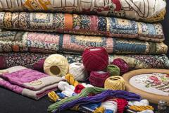 quilting equipment and fabrics. - stock photo