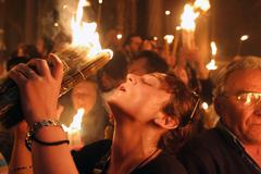 Miracle of holy fire that happens every year in jerusalem in holy sepulchre. Stock Photos