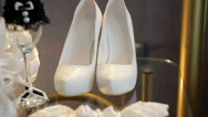 Stock Video Footage of white bridal shoes and wedding accessories on the table