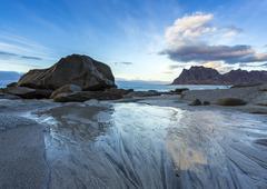 Scandinavia, Norway, Lofoten, rocks in sundown, coastline at Utakleiv - stock photo