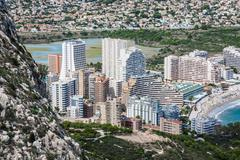 Mediterranean resort calpe, spain with lagoon las salinas and hotel buildings Stock Photos