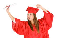 Graduate: cheering woman looks at diploma Stock Photos