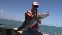 Woman holding big deep sea fish - stock footage