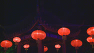 Stock Video Footage of Chinese lanterns swaying in front of pagoda
