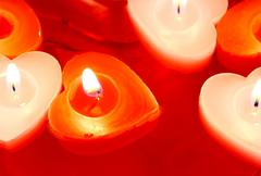 Red and white candles for valentine's day Stock Photos