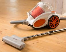 Cleaning of the apartment. vacuum cleaner on the floor Stock Photos