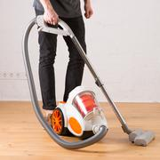 Cleaning with vacuum cleaner in living room Stock Photos