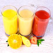 oranges, bananas, strawberry slice, juice in glass - stock photo