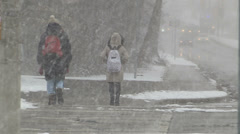 People walking in severe cold weather and snow storm Stock Footage