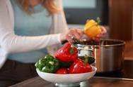 Stock Photo of housewife cutting fresh bell peppers