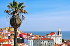 alfama and the tagus river in lisbon, portugal - stock photo