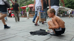 Young boy singing on street Stock Footage