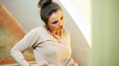 Woman improving blouse in front of mirror and smiling. Stock Footage