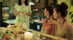 Women bringing nachos in house party and couple background. Stock Footage
