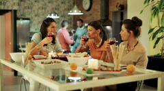 Women parting in house with man in background. Stock Footage