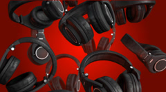 3D Rotating head phones on red background HD Stock Footage