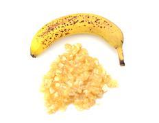 spotty ripe whole banana with mashed fruit - stock photo