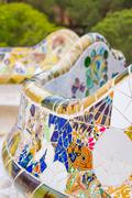 colorful mosaic bench of park guell in barcelona - stock photo