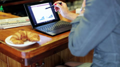 Businesswoman working on laptop and talking on cellphone flank, steadycam shot. - stock footage