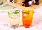 Stock Photo of mojito and orange cocktails with holiday background