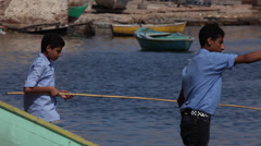 Boys fishing in Alexandria, Egypt - stock footage