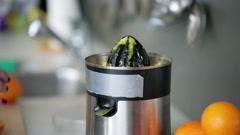 Woman hands preparing orange juice, closeup. Stock Footage