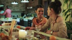 Women partying and talking couple background in kitchen. Stock Footage