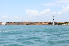 murano island with lighthouse, view from sea - stock photo